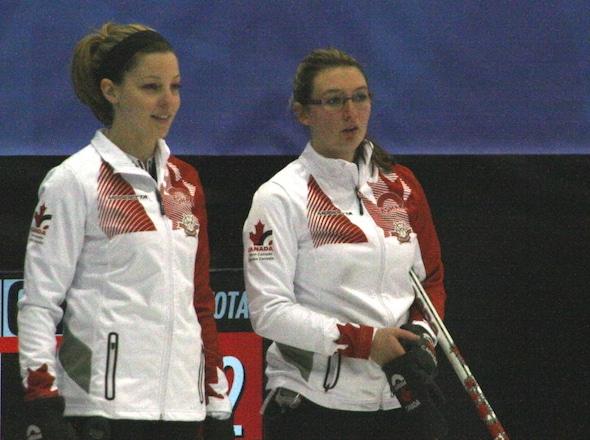 Team Canada's Breanne Meakin, left, and Lauren Horton discuss shot options. (Photo, Canadian Interuniversity Sport)