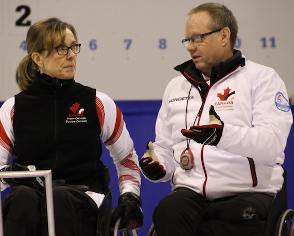 Team Canada's Sonja Gaudet, left, and Dennis Thiessen discuss strategy during Saturday's game. (Photo, World Curling Federation)