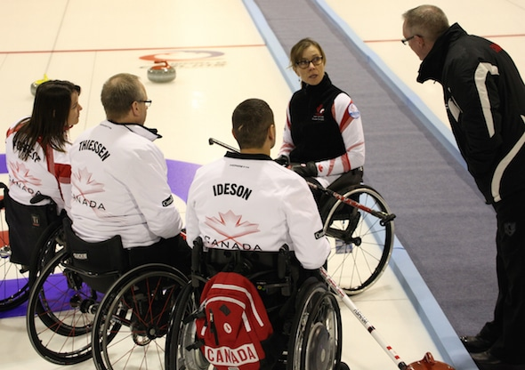 Team Canada coach Joe Rea, right, discusses shot options with the team, from left, Ina Forrest, Dennis Thiessen, Mark Ideson and Sonja Gaudet. (Photo, World Curling Federation/Alina Pavlyuchik)