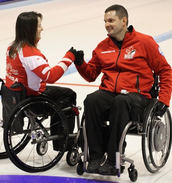 Team Canada's Ina Forrest, left, and Mark Ideson celebrate Monday's win over Sweden. (Photo, World Curling Federation/Alina Pavlyuchik)