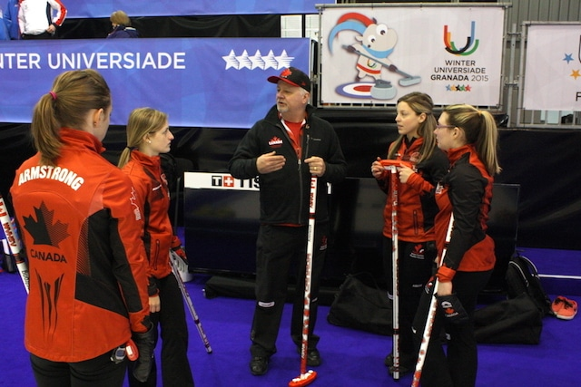 Team Canada's Jessica Armstrong, Lynn Kreviazuk, Breanne Meakin and Lauren Horton receive some last-minute tips before their semifinal against Russia at the 2015 Universiade in Granada, Spain (Photo Brian Chick)