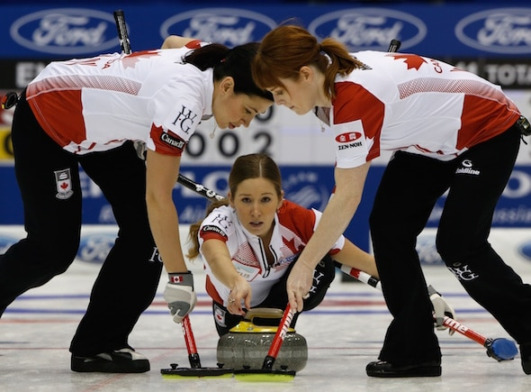 Team Canada vice-skip Kaitlyn Lawes delivers rock to sweepers Jill Officer, left, and Dawn McEwen. (Photo, WCF/Richard Gray)