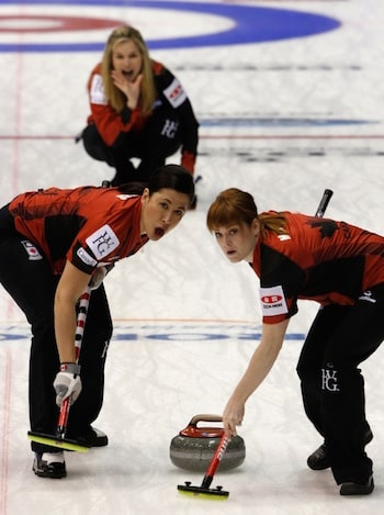 Team Canada skip Jennifer Jones calls instructions to sweepers Jill Officer, left, and Dawn McEwen. (Photo, WCF/Richard Gray)