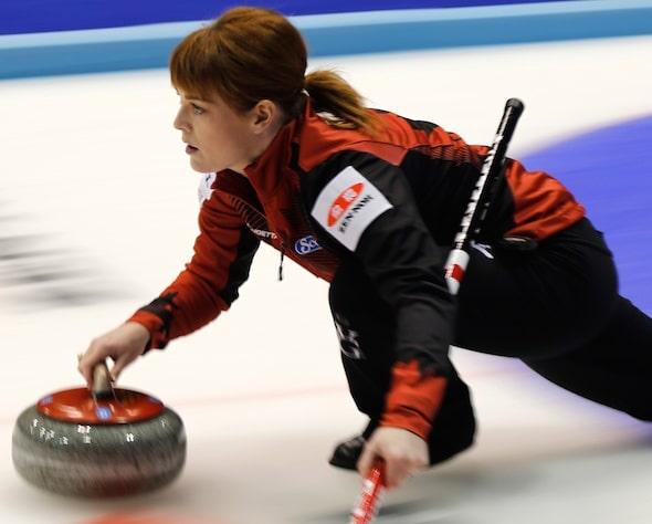 Team Canada lead Dawn McEwen delivers her rock in Sapporo. (Photo, WCF/Richard Gray)