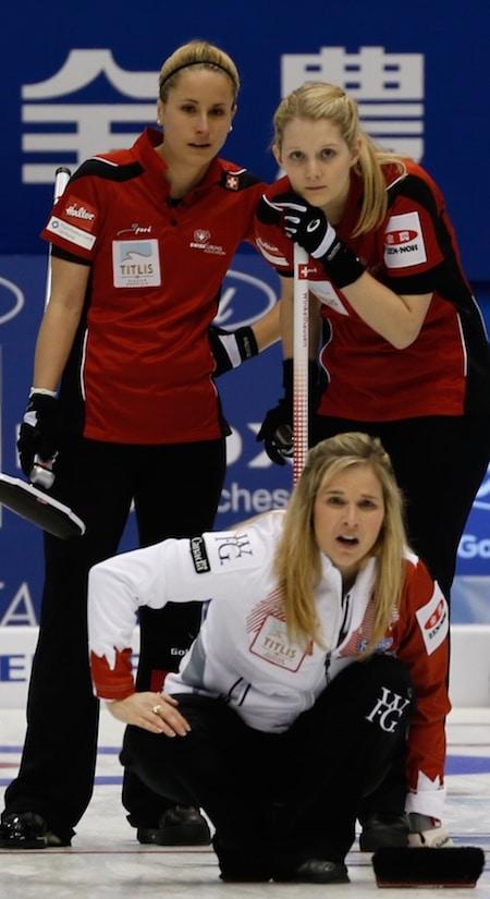Canada's Jennifer Jones watches her shot as Switzerland's Nicole Schwägli, left, and Marisa Winkelhausen look on. (Photo, WCF/Richard Gray)