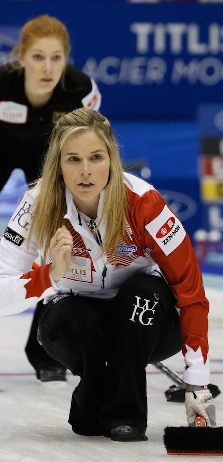 Team Canada skip Jennifer Jones watches her shot as Germany's Stella Heiss looks over her shoulder. (Photo, WCF/Richard Gray)