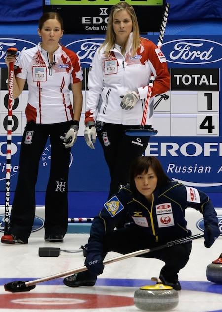 Canada's Kaitlyn Lawes and Jennifer Jones look on as Japanese skip Ayumi Ogasawara watches her team's shot. (Photo, WCF/Richard Gray)