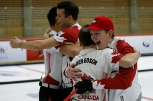 Hugs all around for the Canadian men after winning the gold medal at the World Juniors (Photo: WCF/Richard Gray)
