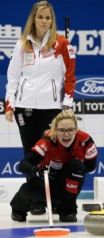 Swiss skip Alina Pätz calls out to her sweepers as Jennifer Jones looks on. (Photo, WCF/Richard Gray)