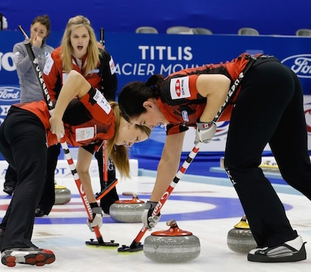 Jennifer Jones calls instructions to sweepers Kaitlyn Lawes, left, and Jill Officer. (Photo, WCF/Richard Gray)
