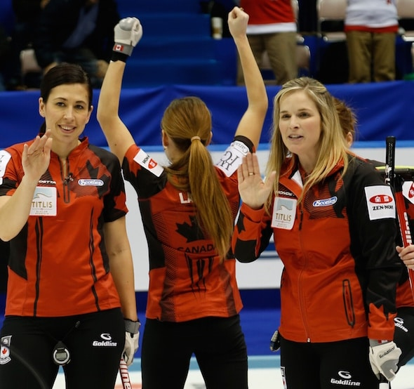 Team Canada's Jill Officer, Kaitlyn Lawes and Jennifer Jones celebrate semifinal win. (Photo, WCF/Richard Gray)