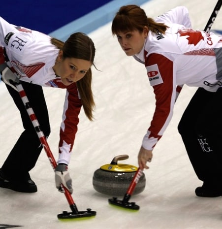 Team Canada's Kaitlyn Lawes, left, sweeps with Dawn McEwen. (Photo, WCF/Richard Gray)
