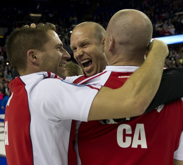 From left, John Morris, Pat Simmons and Nolan Thiessen celebrate their win on Sunday night. (Photo, Curling Canada/Michael Burns)