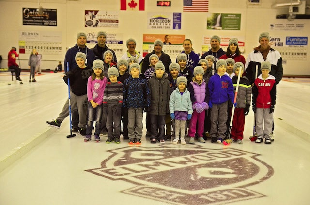Young curlers and their instructors on the ice at Elmwood Curling Club in Winnipeg (Photo courtesy of B. Quesnel)