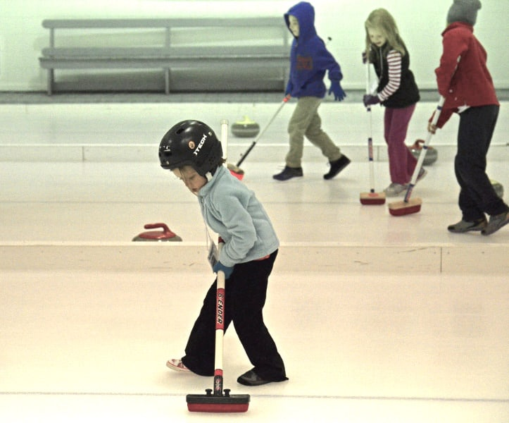 The youngest curlers work on their sweeping technique in Elmwood Curling Club's youth program (Photo courtesy B. Quesnel)