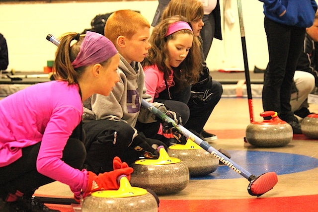 Young curlers receive instruction on the ice at Rockslide Curling Camp 2014 (Photo courtesy CurlBC)