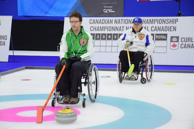 Darwin Bender (SK) and Gerry Austgarden (BC) in action during the Page Playoff 3 vs 4 game at the 2015 Canadian Wheelchair Curling Championship (Photo Morgan Daw)