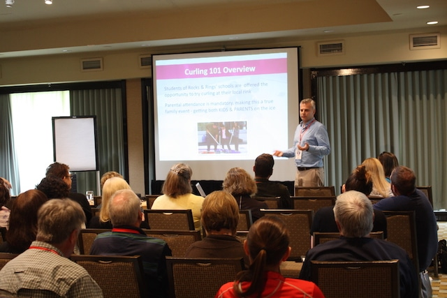 """Chad McMullen of Rock Solid Productions, Inc. presents the success of the """"Curling 101"""" program during a session on marketing best practices (Photo Curling Canada/Brian Chick)"""