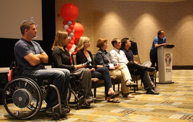 """Athletes and coaches participate in a panel discussion called """"Lessons from the Coaches' Bench"""" featuring (left to right) Mark Ideson, Sonja Gaudet, Helen Radford, Andrea Ronnebeck, Richard Hart, Kyle Paquette and moderator Paul Webster (Photo Curling Canada/Brian Chick)"""