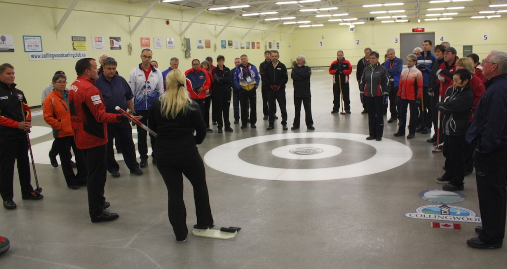Competitive curler Danielle Inglis prepares to demonstrate delivery techniques during a technical update session facilitated by National Development Coach Paul Webster and Curl Atlantic's Helen Radford (Photo Curling Canada/Brian Chick)