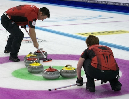 Wayne Tuck and Kim Tuck competing at the 2014 World Mixed Doubles Championship. New rules being tested in New Zealand mean that a skip will no longer be required to be in the house for shots. (Photo, World Curling Federation/Richard Gray)