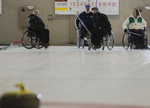 Members of Team Saskatchewan, from left, Darwin Bender, Larry Schrader, Gil Dash and Marie Wright, practise at the Callie Club.