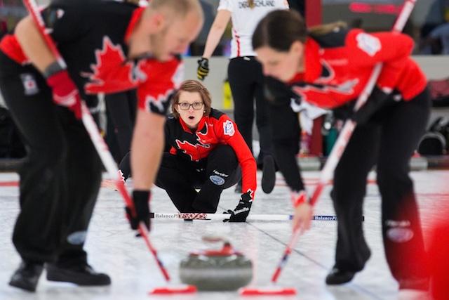 Canada's Jolene Campbell, Chris Haichert and Teejay Haichert in action at the 2015 World Mixed Curling Championship in Berne, Switzerland (Photo WCF/Céline Stucki)