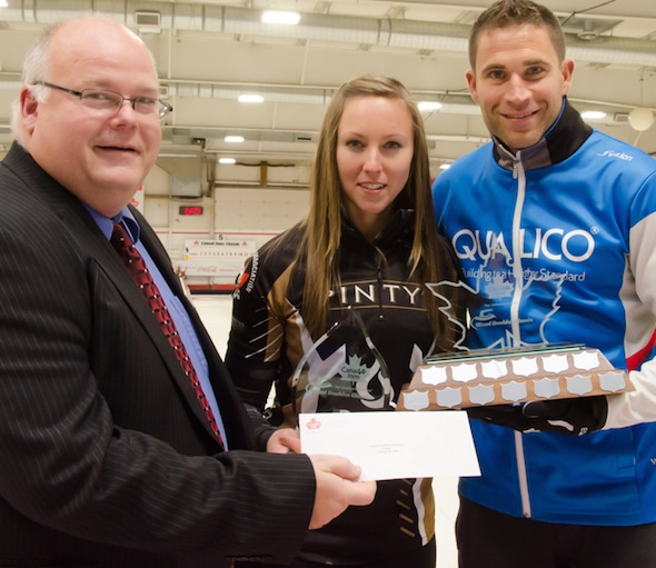 Trent Ward, left, General Manager of Canad Inns Destination Centre Portage la Prairie, presents the inaugural Canad Inns Mixed Doubles Classic trophy to Rachel Homan and John Morris. (Photos, courtesy Canad Inns)