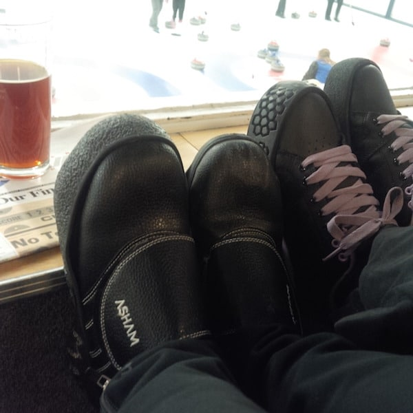 The curling shoes of two league participants - illustrating their friendship and sense of belonging to the sport (Photo courtesy of S. Barrick)