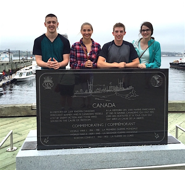 (From left to right) Youth Olympians Tyler Tardi, Karlee Burgess, Sterling Middleton and Mary Fay stop for a moment of national pride while exploring the Halifax waterfront. (Photo courtesy Karlee Burgess)