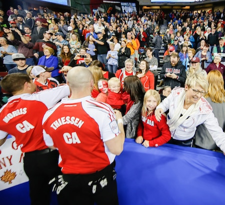 Team Canada family members celebrate after the Tim Hortons Brier final. (Photo, courtesy Neil Zee Photography)