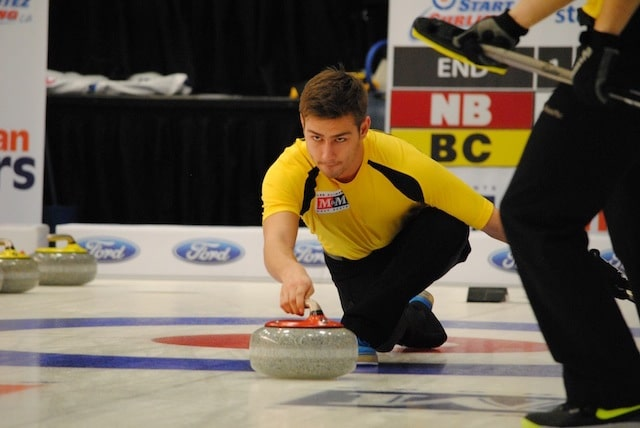Andrew Burgess throws third stones for team New Brunswick at the 2015 M&M Meat Shops Canadian Juniors (Curling Canada/Amanda Rumboldt Photo)