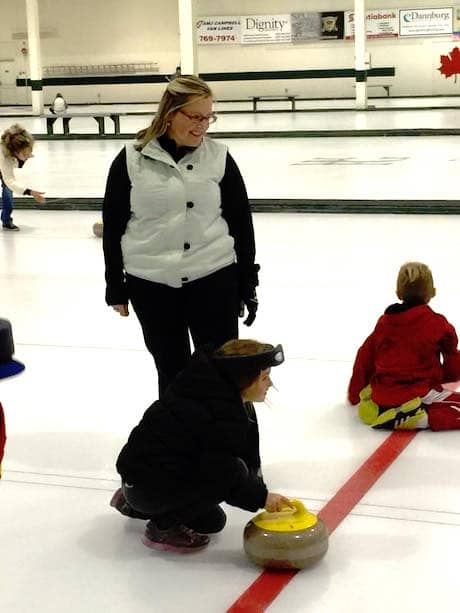 Kelly Scott watches young curlers get a feel for the ice during a Learn-to-Curl session she organized at the Kelowna Curling Club in early November (Photo courtesy Clare Peterson)