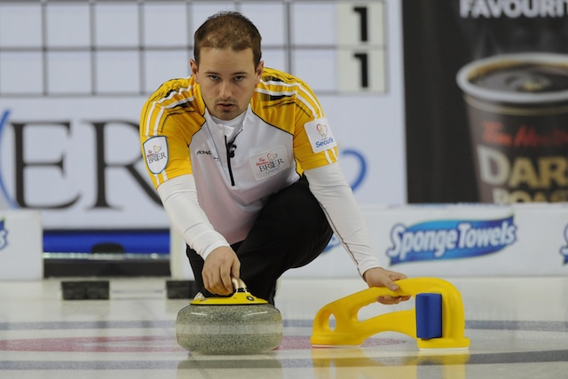 Reid Carruthers delivers a rock at the 2015 Tim Hortons Brier with assistance from his ProSlide (Curling Canada/Michael Burns photo)