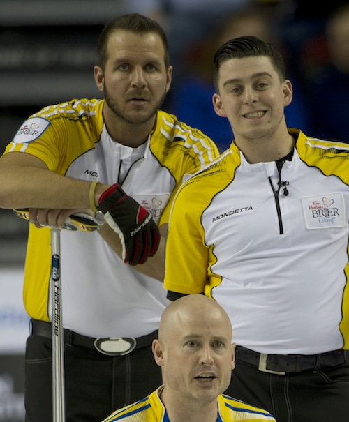 Colin Hodgson (right), with Derek Samagalski and Alberta skip Kevin Koe at the 2015 Tim Hortons Brier (Curling Canada/Michael Burns photo)