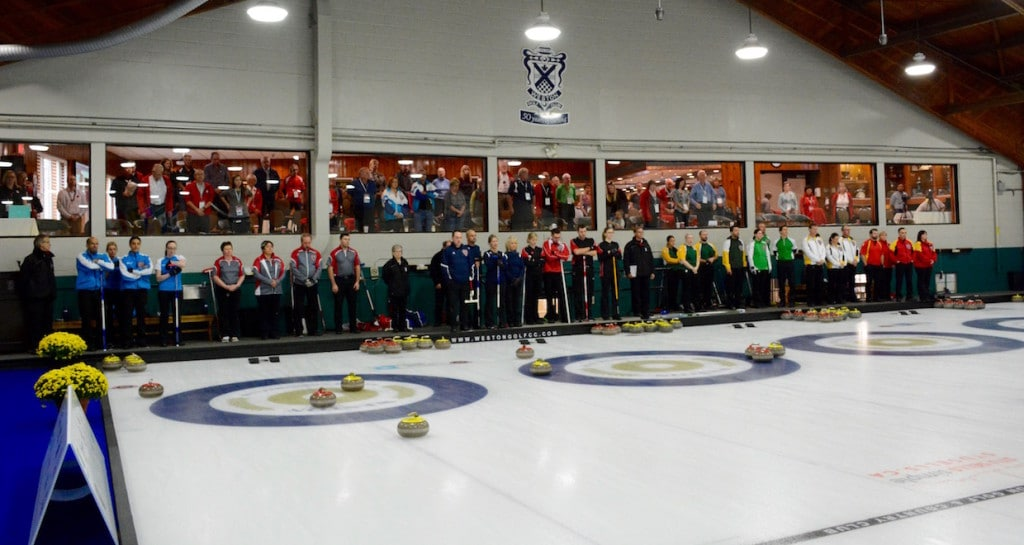 Teams at the Canadian Mixed Curling Championship stand for a moment of silence at 11 o'clock to mark Remembrance Day (Curling Canada/Sonja DiMarco Photo)
