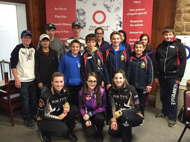 "Giving back comes naturally to curlers, as OYCL members learned at an early-season ""Ice-Breaker"" with elite curlers Emma Miskew, Cheryl Kreviazuk and Lisa Weagle. (Photo courtesy of M. Bourguignon)"