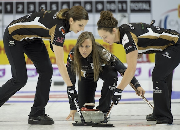 Ottawa's Rachel Homan delivers her shot to sweepers Lisa Weagle, left, and Joanne Courtney during action Wednesday at the 2015 Home Hardware Canada Cup. (Photo, Curling Canada/Michael Burns)