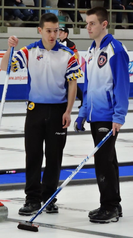 B.C. skip Tyler Tardi, right, discusses shot options with vice-skip Daniel Wenzek during Sunday night's win. (Photo, Curling Canada)
