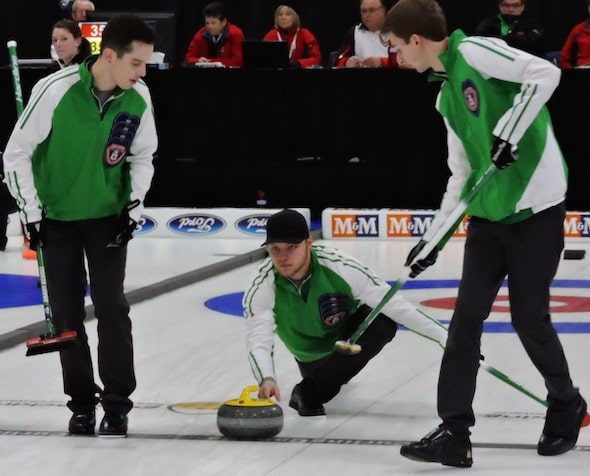 Jake Hersikorn delivers rock to sweepers Brady Kendel and Nick Neufeld during action Monday morning. (Photo, Curling Canada)