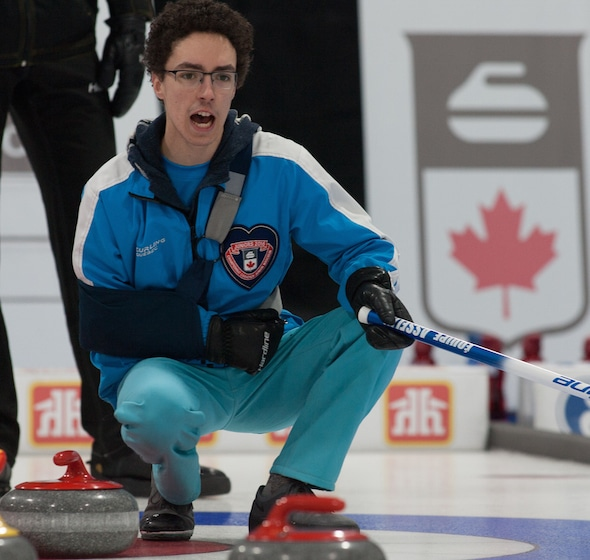 Quebec skip Félix Asselin wore a shoulder sling during his team's win over New Brunswick on Thursday. (Photo, Curling Canada/Bob Wilson)