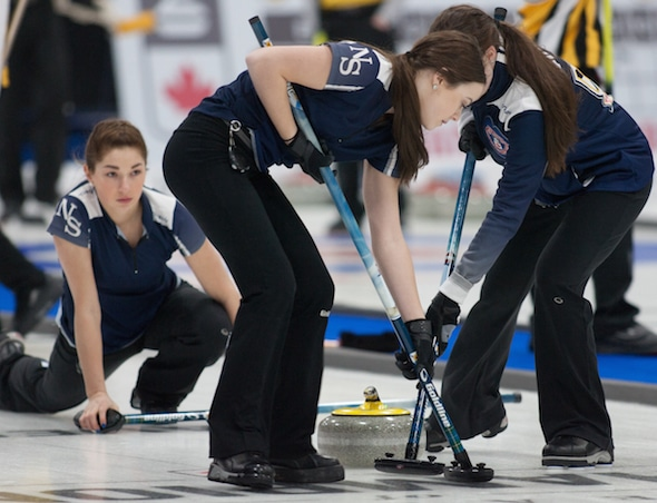 Nova Scotia second Karlee Burgess delivers rock to sweepers Janique LeBlanc, left, and Kristin Clarke. (Photo, Curling Canada/Bob Wilson)