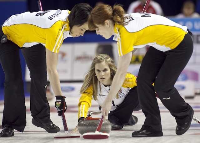 Team Manitoba, Skip Jennifer Jones, throws and second Jill Officer, lead Dawn Askin in a semeifinal win at The 2013 Scotties Tournament of Hearts, February 16-24, Kingston Onatrio, The Canadian Womans Curling Championship.