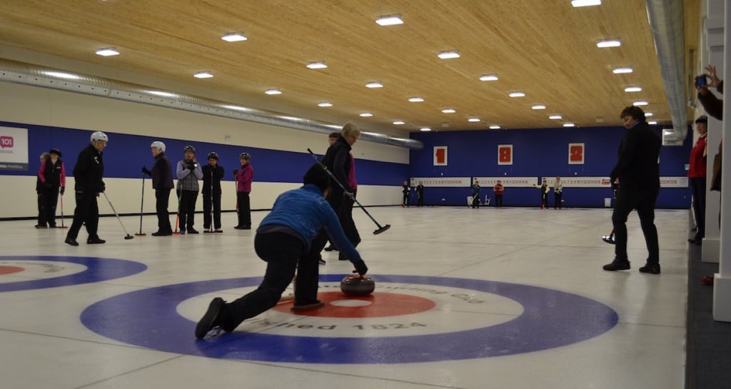 The first rock is thrown to mark the return to curling at the repaired Halifax Curling Club (Photo by Jordan Whitehouse)