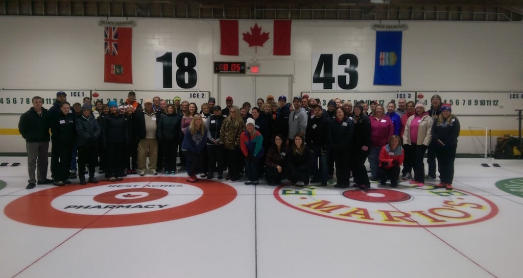Participants in the Paris Curling Club's 2015-2016 Adult Learn To Curl program gather on the ice (Photo courtesy of Mark Stouffer)
