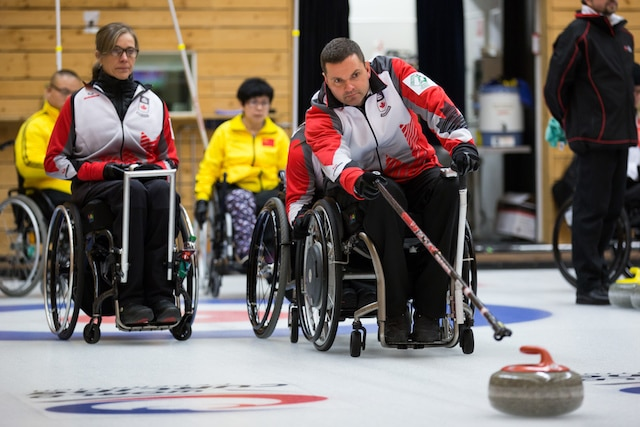 Team Canada second Sonja Gaudet watches as lead Mark Ideson delivers his rock at the 2016 World Wheelchair Curling Championship on Tuesday morning in Lucerne, Switzerland (WCF/Céline Stucki photo)