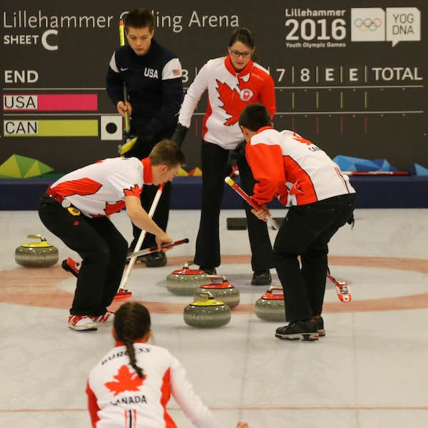 Sweepers Sterling Middleton and Tyler Tardi follow Karlee Burgess's rock into the house as skip Mary Fay calls line in the gold medal game of the 2016 Youth Olympics in Lillehammer, Norway (WCF/Richard Gray photo)