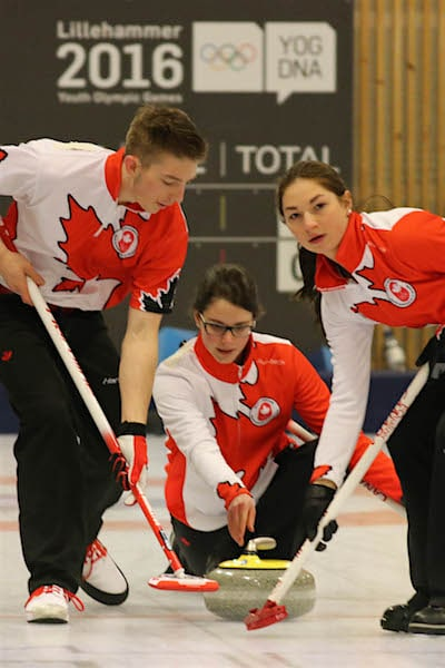 Team Canada skip Mary Fay delivers her rock at the 2016 Youth Olympic Games in Lillehammer, Norway (WCF/Richard Gray photo)