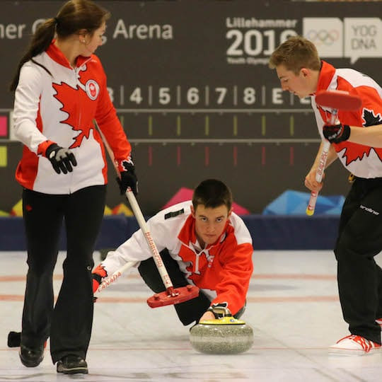 Tyler Tardi delivers his rock assisted by sweepers Karlee Burgess and Sterling Middleton at the 2016 Youth Olympic Games in Lillehammer, Norway (WCF/Richard Gray photo)