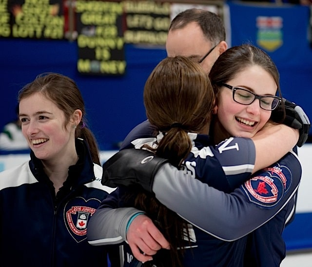 Nova Scotia skip Mary Fay, gets her hugs from teamates third Kristin Clarke, second Karlee Burgess after guiding her Chester Nova Scotia squad to a 9-5 victory over British Columbia in the woman's final at the 2016 Canadian Junior Curling Championship (Curling Canada/Michael Burns photo)